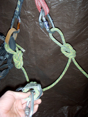 Taking the belay device off the anchor and…