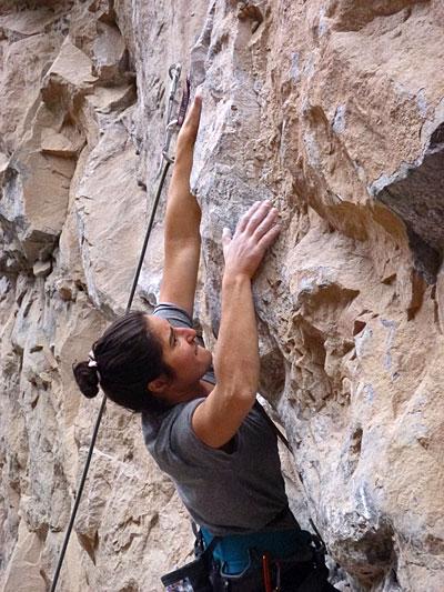 """Julie Schoenfeld grapples with """"Poetic Justice"""" (5.13a) at Rifle Mountain Park. Photo by Derek Franz."""
