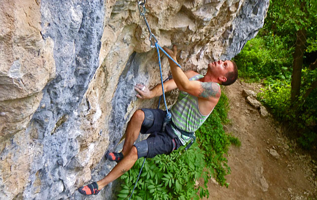 Mike Humphries gets amped on Espresso (5.12d) at Rifle Mountain Park. Photo by Derek Franz.