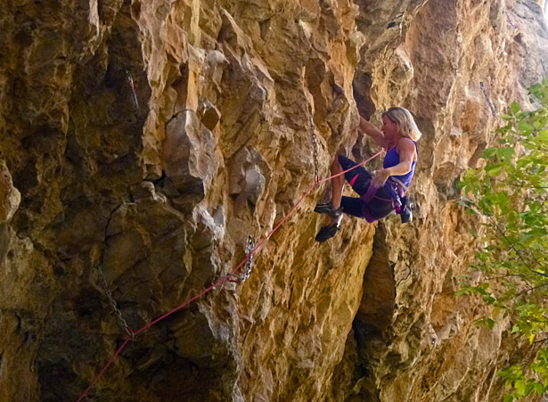 "Wendy Williams stays cool on ""The Path"" (5.13c) in Rifle Mountain Park. Derek Franz photo."